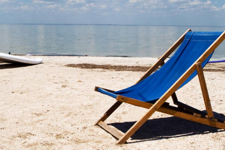 a chair sitting on the beach